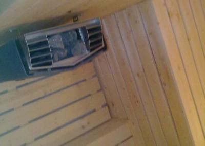 Ovn og sittebenk i sauna